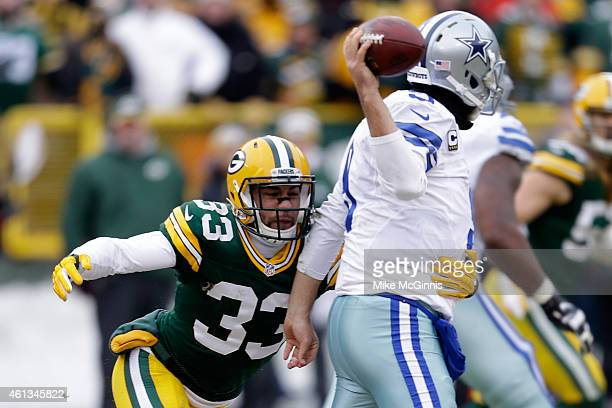 Micah Hyde of the Green Bay Packers hits quarterback Tony Romo of the Dallas Cowboys as he throws the ball during the 2015 NFC Divisional Playoff...