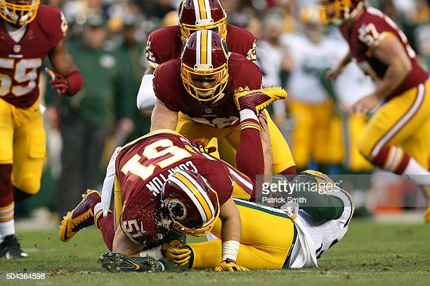 Micah Hyde of the Green Bay Packers is tackled by inside linebacker Will Compton of the Washington Redskins in the first quarter during the NFC Wild...