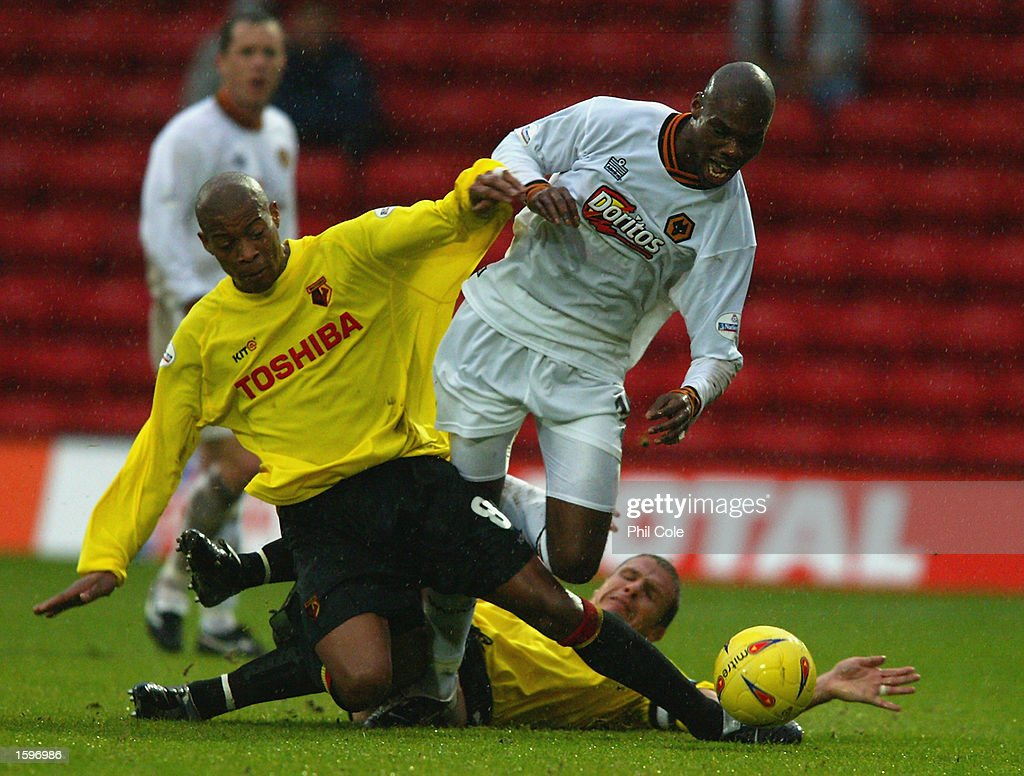 Micah Hyde of Watford brings down George Ndah of Wolverhampton Wanderers during the Nationwide League Division One match held on November 2, 2002 at Vicarage Road in Watford, England. The match ended in a 1-1 draw. DIGITAL