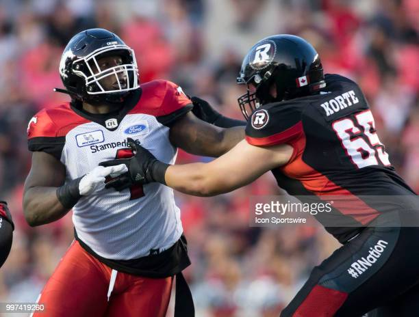 Micah Johnson of the Calgary Stampeders rushes the Ottawa Redblacks line in a regular season Canadian Football League game played at TD Place Stadium...