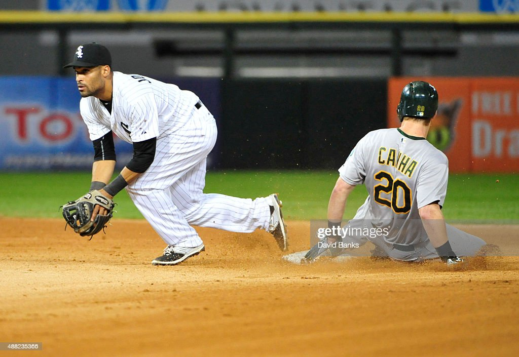Micah Johnson #7 of the Chicago White Sox forces out Mark Canha #20 of the Oakland Athletics during the sixth inning on September 14, 2015 at U.S. Cellular Field in Chicago, Illinois.