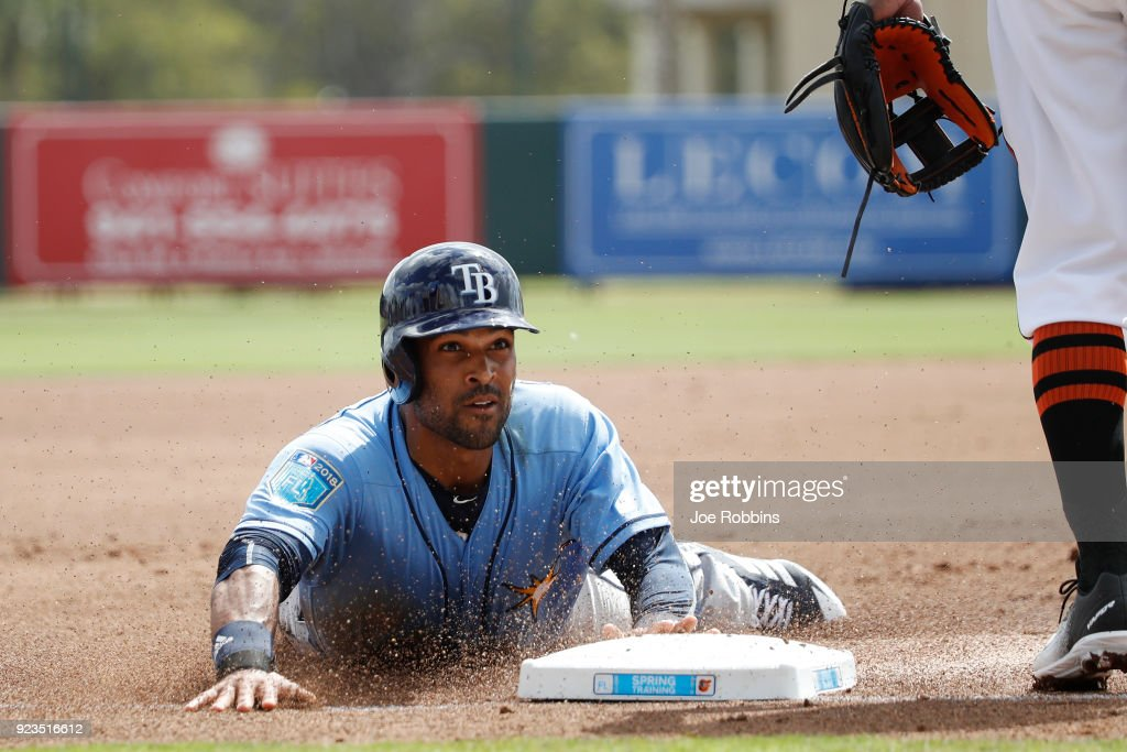 Micah Johnson #7 of the Tampa Bay Rays slides head first into third base against the Baltimore Orioles during a Grapefruit League spring training game at Ed Smith Stadium on February 23, 2018 in Sarasota, Florida. The Rays won 6-3.
