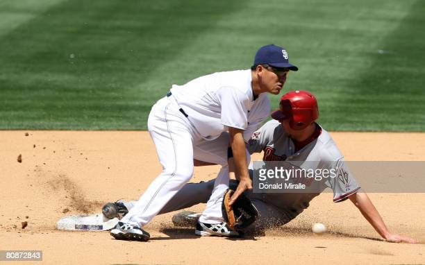 Micah Owings of the Arizona Diamondbacks steals second base under the tag of Tadahito Iguchi of the San Diego Padres during their MLB game on April...
