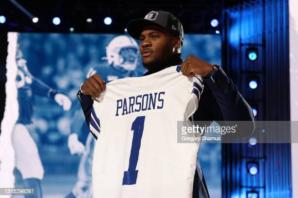 Micah Parsons poses onstage after being selected 12th by the Dallas Cowboys during round one of the 2021 NFL Draft at the Great Lakes Science Center...