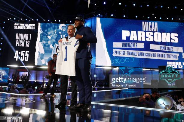Micah Parsons poses with NFL Commissioner Roger Goodell onstage after being selected 12th by the Dallas Cowboys during round one of the 2021 NFL...