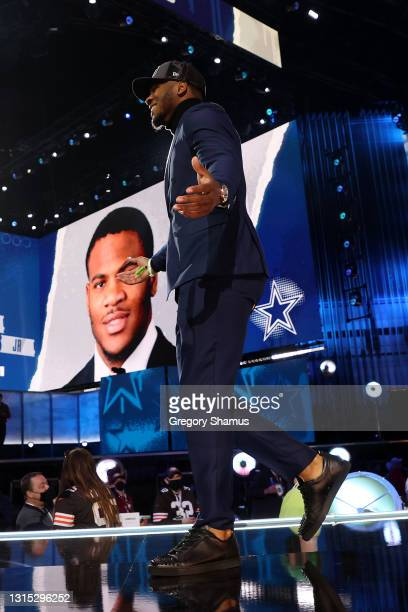 Micah Parsons walks onstage after being selected 12th by the Dallas Cowboys during round one of the 2021 NFL Draft at the Great Lakes Science Center...