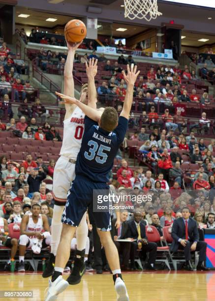 Micah Potter of the Ohio State Buckeyes attempts a lay up while being guarded by Zane Najdawi of the Citadel Bulldogs during the game between the...