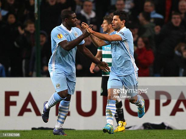 Micah Richards celebrates with goal scorer Sergio Aguero of Man City during the UEFA Europa League round of 16 second leg match between Manchester...