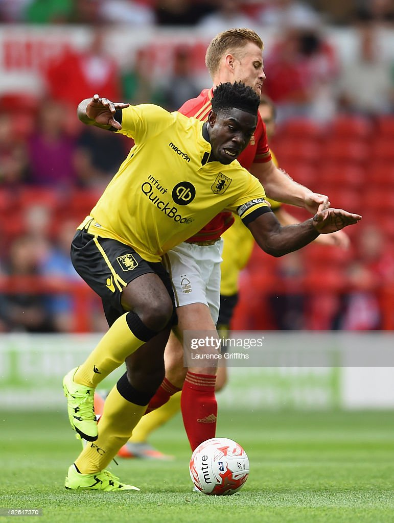 Micah Richards of Aston Villa battles with Matt Mills of nottingham Forest during the Pre Season Friendly match between Nottingham Forest and Aston Villa at City Ground on August 1, 2015 in Nottingham, England.