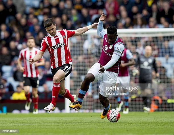 Micah Richards of Aston Villa is challenged by Shane Long of Southampton during the Barclays Premier League match between Aston Villa v Southampton...