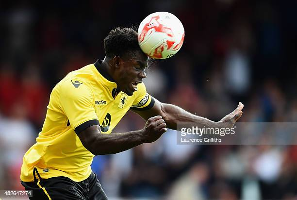 Micah Richards of Aston Villa rises for a header during the Pre Season Friendly match between Nottingham Forest and Aston Villa at City Ground on...