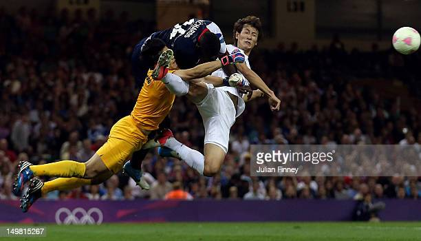 Micah Richards of Great Britain goes for the ball wiith Sungryong Jung of Korea and Dongwon Ji of Korea during the Men's Football Quarter Final match...