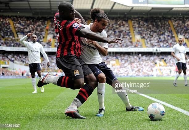 Micah Richards of Manchester City battles for the ball with Benoit Assou-Ekotto of Tottenham during the Barclays Premier League match between...