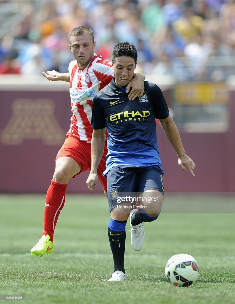 Micah Richards #2 of Manchester City controls the ball against Avraam Papadopoulos #21 of Olympiacos during the first half of the International Champions Cup match on August 2, 2014 at TCF Bank Stadium in Minneapolis, Minnesota.