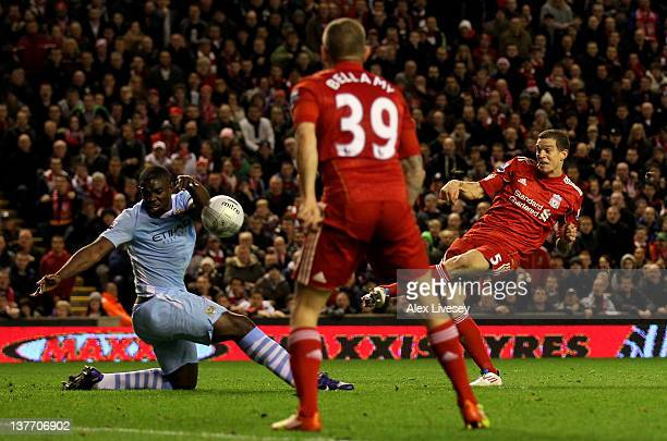 Micah Richards of Manchester City handballs to concede a penalty during the Carling Cup Semi Final Second Leg match between Liverpool and Manchester...