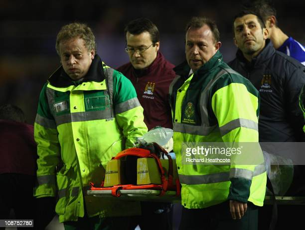 Micah Richards of Manchester City is stretchered off injured during the Barclays premier league match between Birmingham City and Manchester City at...