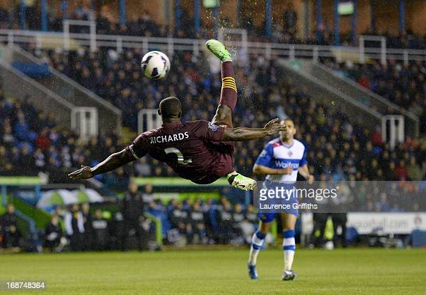 Micah Richards of Manchester City tries a spectacular overhead kick during the Barclays Premier League match between Reading and Manchester City at...