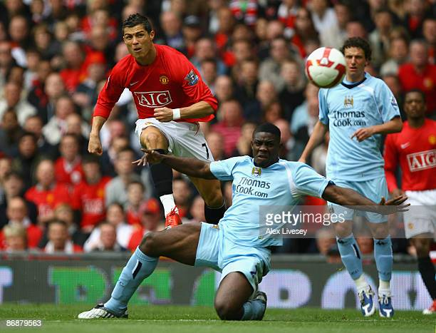 Micah Richards of Manchester City tries to block the shot of Cristiano Ronaldo of Manchester United during the Barclays Premier League match between...