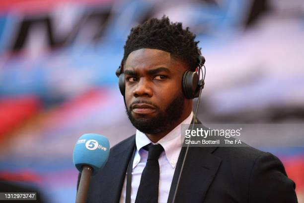 Micah Richards, Pundit and former Manchester City player looks on prior to the Semi Final of the Emirates FA Cup match between Manchester City and...