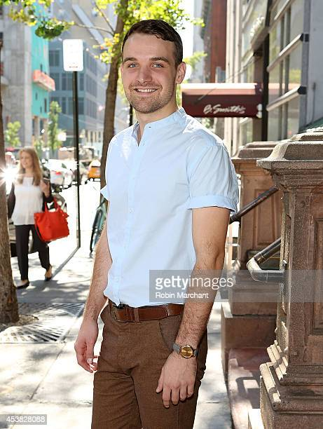 """Micah Stock attends the """"It's Only A Play"""" Cast Photocall at Joe Allen Restaurant on August 19, 2014 in New York City."""