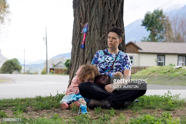 Micha Kingston holds her daughter Mimi Kingston on September 1 near their temporary home in Lillooet, British Columbia, after Canada's wildfires...