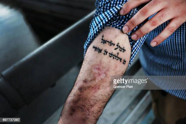 Michael a patient at a Brooklyn methadone clinic for those addicted to heroin displays a Hebrew tatoo of the shema prayer in Judaism that he looks to...