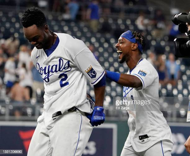 Michael A. Taylor of the Kansas City Royals is congratulated by Jarrod Dyson after his walk-off single in the 10th inning against the Chicago White...