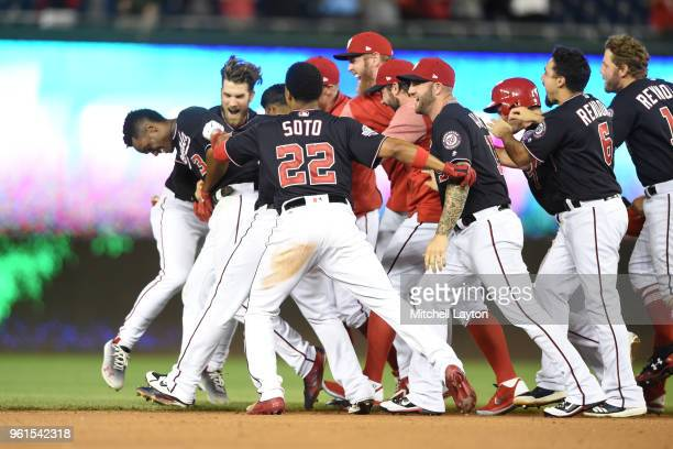 Michael A Taylor of the Washington Nationals celebrates with teammates after hitting a game winning double in the bottom of the ninth inning against...