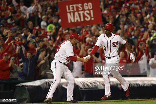 Michael A Taylor of the Washington Nationals celebrates with Bob Henley of the Washington Nationals after hitting a three run home run against the...