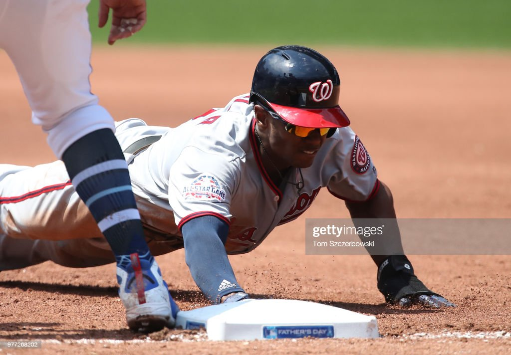Michael A. Taylor #3 of the Washington Nationals dives back safely to first base on a pick-off attempt in the fourth inning during MLB game action against the Toronto Blue Jays at Rogers Centre on June 17, 2018 in Toronto, Canada.