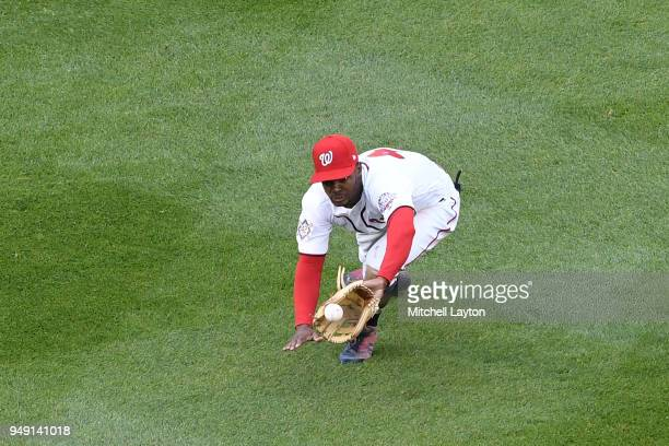 Michael A Taylor of the Washington Nationals dives to catch a ball during a baseball game against the Colorado Rockies at Nationals Park on April 15...