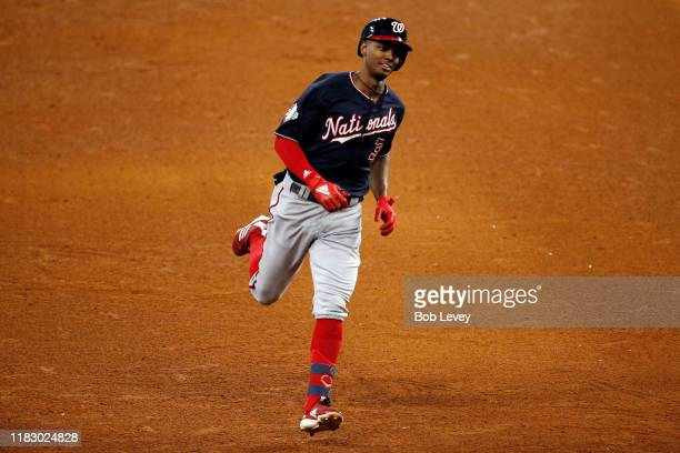 Michael A. Taylor of the Washington Nationals hits a solo home run against the Houston Astros during the ninth inning in Game Two of the 2019 World...