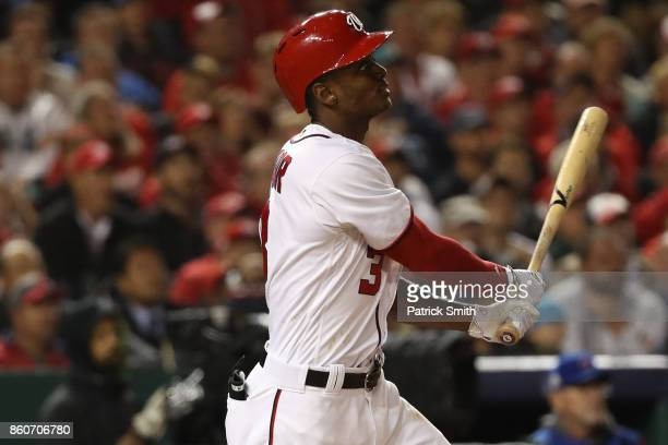 Michael A Taylor of the Washington Nationals hits a three run home run against the Chicago Cubs during the second inning in game five of the National...