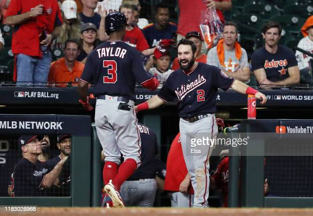 Michael A Taylor of the Washington Nationals is congratulated by his teammate Adam Eaton after he hits a solo home run against the Houston Astros...