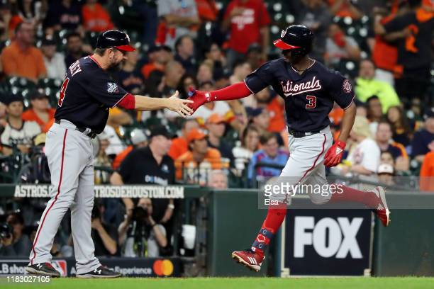 Michael A Taylor of the Washington Nationals is congratulated by his third base coach Bob Henley after he hits a solo home run against the Houston...