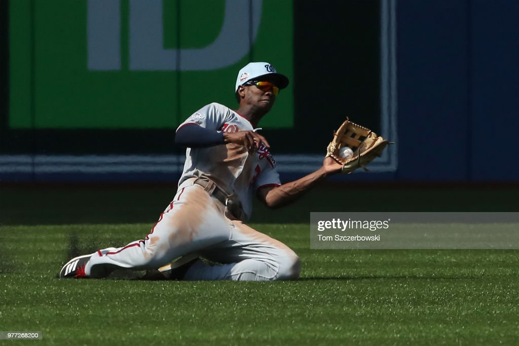 Michael A. Taylor #3 of the Washington Nationals makes a sliding catch in the seventh inning during MLB game action against the Toronto Blue Jays at Rogers Centre on June 17, 2018 in Toronto, Canada.