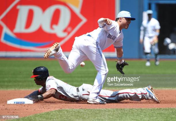 Michael A Taylor of the Washington Nationals steals second base in the second inning during MLB game action as Aledmys Diaz of the Toronto Blue Jays...
