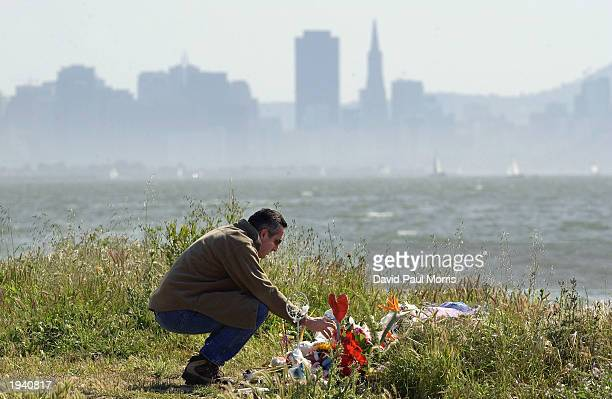 Michael Accurso of El Sobrante California pours water on some flowers at a memorial that includes flowers candles and stuffed toys April 19 2003 in...