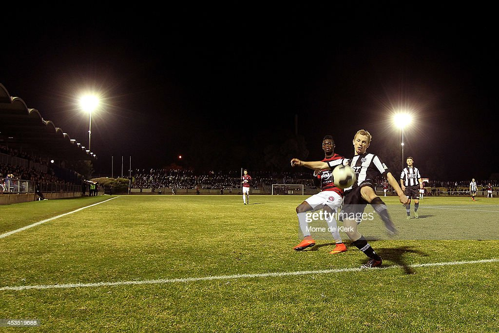 Michael Acton of Adelaide City clears the ball during the FFA Cup match between Adelaide City and Western Sydney Wanderers at Marden Sports Complex on August 12, 2014 in Adelaide, Australia.