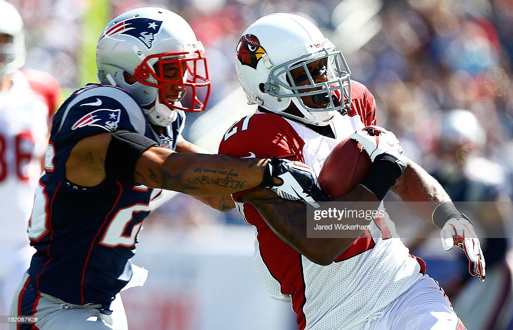 Michael Adams #27 of the Arizona Cardinals runs with the ball through Patrick Chung #25 of the New England Patriots during the game on September 16, 2012 at Gillette Stadium in Foxboro, Massachusetts.