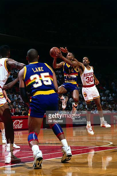 Michael Adams of the Denver Nuggets takes a jumper during the 1990 NBA game against the Houston Rockets in Houston Texas NOTE TO USER User expressly...