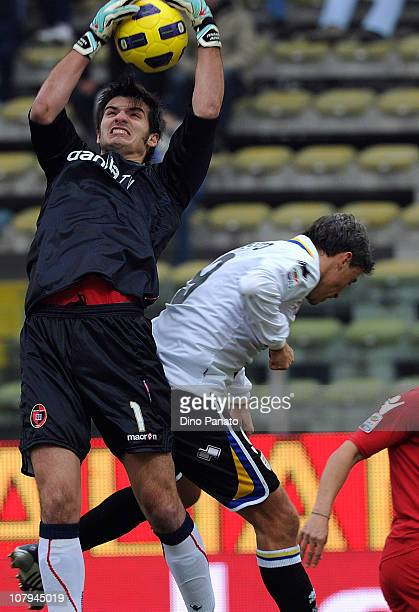 Michael Agazzi goal keeper of Cagliari catches the ball in the air ahead of Hernan Crespo of Parma during the Serie A match between Parma FC and...