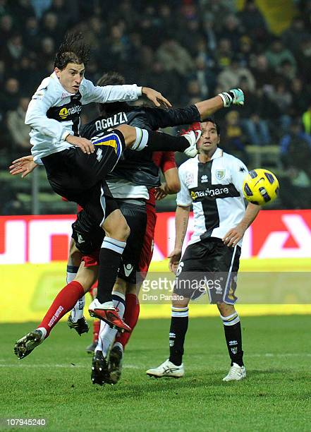 Michael Agazzi goal keeper of Cagliari catches the ball in the air ahead of Gabriel Paletta of Parma during the Serie A match between Parma FC and...