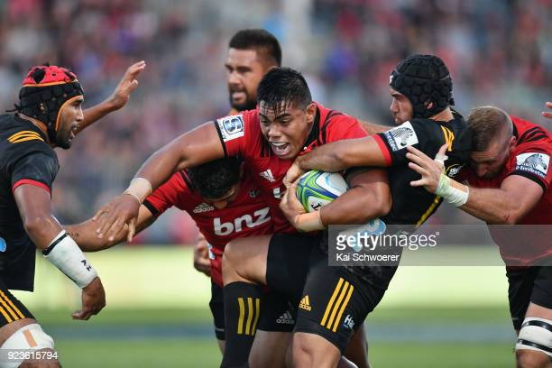 Michael Alaalatoa of the Crusaders is tackled by Charlie Ngatai of the Chiefs during the round two Super Rugby match between the Crusaders and the...