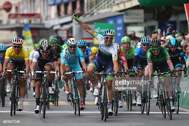 Michael Albasini of Switzerland and Orica GreenEdge celebrates victory in a sprint finish from Tony Hurel of France and Europcar Giacomo Nizzolo of...