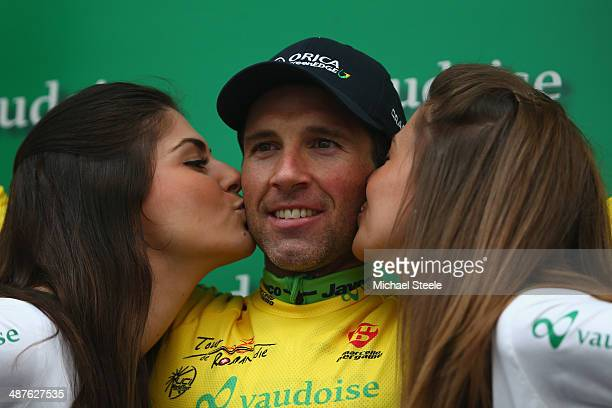 Michael Albasini of Switzerland and Orica GreenEdge receives kisses from the podium girls after claiming the yellow leaders jersey after his victory...