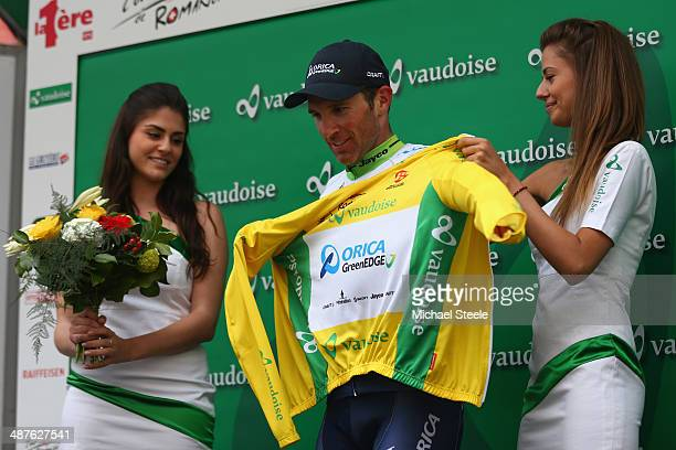 Michael Albasini of Switzerland and Orica GreenEdge receives the yellow leaders jersey after his victory in stage two of the Tour de Romandie from...