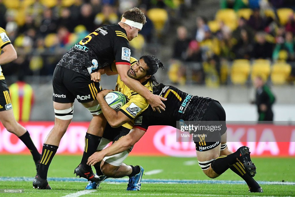 Michael Allardice and Sam Cane tackle Michael Fatialofa of the Hurricanes of the Chiefs during the round nine Super Rugby match between the Hurricanes and the Chiefs at Westpac Stadium on April 13, 2018 in Wellington, New Zealand.