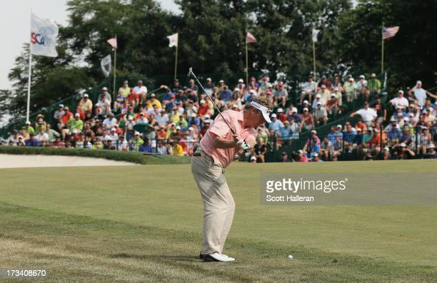Michael Allen hits a pitch shot on the 18th hole during the third round of the 2013 US Senior Open Championship at Omaha Country Club on July 13 2013...