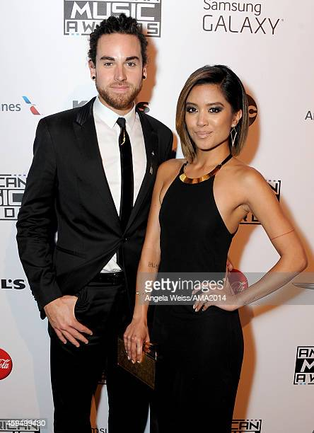 Michael Alvarado and Carissa Rae Alvarado of Us The Duo attends the official 2014 American Music Awards after party at the at Nokia Theatre LA Live...